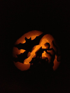 pumpkin carved with a haunted house scene