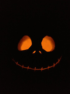 pumpkin carved with a jack skellington face
