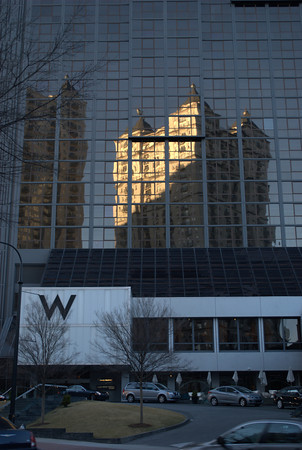 Reflected skyscraper bathed in a wedge of sunset light