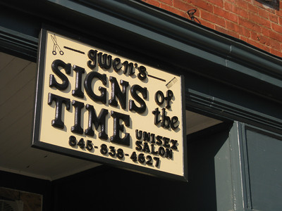 unisex salon sign